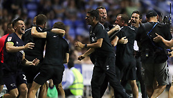 Derby County manager Frank Lampard (right) and the rest of the bench celebrate after Tom Lawrence (not pictured) scores his side's second goal of the game during the Sky Bet Championship match at the Madejski Stadium, Reading.