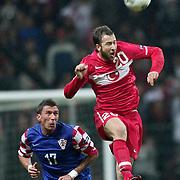 Turkey's Giray KACAR (R) and Croatia's Mario MANDZUKIC (L) during their UEFA EURO 2012 Play-off for Final Tournament First leg soccer match Turkey betwen Croatia at TT Arena in Istanbul Nüovember11, 2011. Photo by TURKPIX