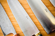 A Japanese type of kitchen knife with a carbon steel core laminated with a soft outer steel made by Murray Carter, 17th generation Yoshimoto Bladesmith, Portland, Oregon, USA