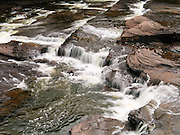 """One of several beautiful falls tumble over """"Nonesuch Shale"""" rock on the Presque Isle River in Porcupine Mountains Wilderness State Park, Michigan, USA."""