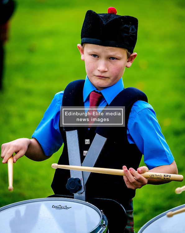 Peebles, Scotland UK  3rd September 2016. Peebles Highland Games, the biggest 'highland' games in the Scottish  Borders took place in Peebles on September 3rd 2016 featuring pipe band contests, highland dancing competitions, haggis hurling, hammer throwing, stone throwing and other traditional events.<br /> <br /> Pictured:  a young drummer playing in a pipe band<br /> <br /> (c) Andrew Wilson   Edinburgh Elite media