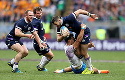 Scotland's Tommy Seymour is tackled during the NatWest 6 Nations match at the Stadio Olimpico, Rome.