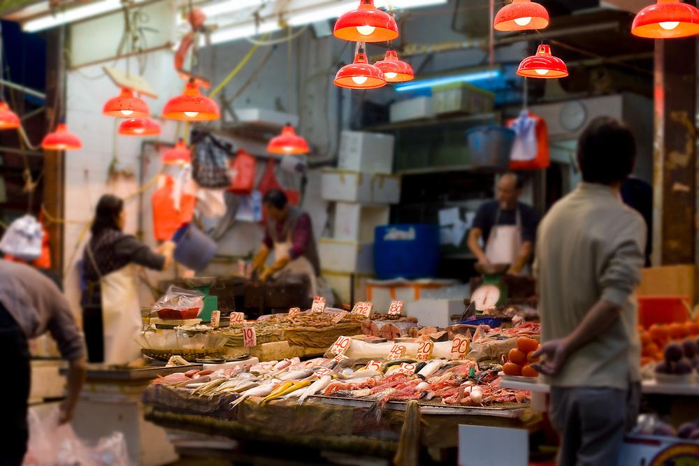 Eastern Hong Kong, Hong Kong Island, Hong Kong, China, Asia - Fresh fish shop on the markets of Chun Yeung Street at North Point district.