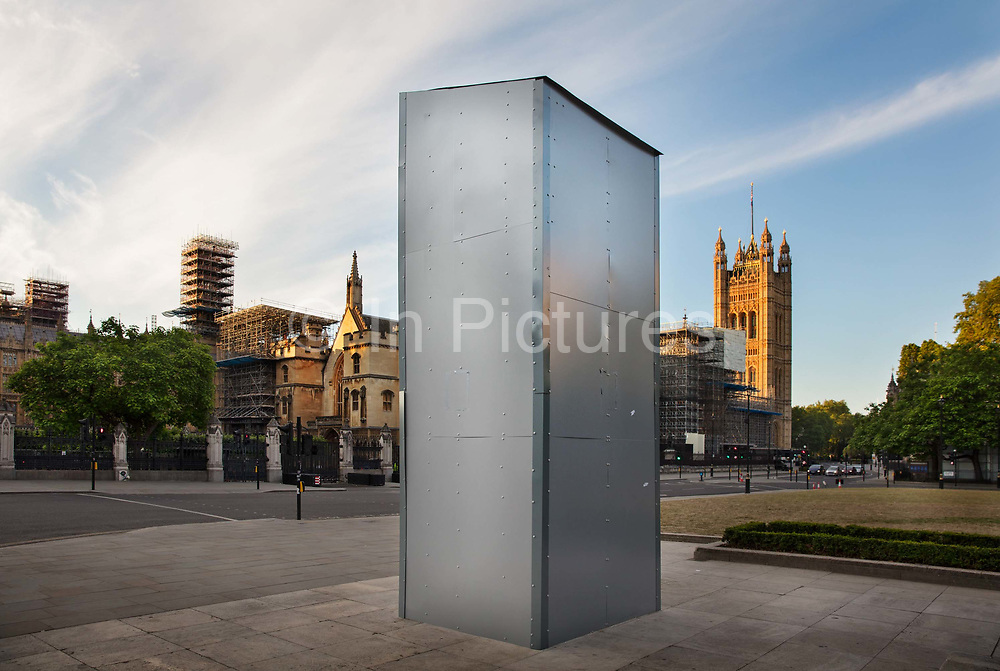 """Hidden beneath the protective cover is a bronze sculpture by Ivor Roberts-Jones of the former British prime minister Winston Churchill, created on 15th June 2020 in Londons Parliament Square, United Kingdom. The statue was boarded up to protect it from attacks by Black Lives Matter protesters who sprayed graffiti on it over two successive days, including the words was a racist. Despite his achievements, there is evidence to suggest Mr Churchill was a white supremacist. He referred to British imperialism as being for the good of the """"primitive"""" and """"subject races"""". As a junior member of parliament, Mr Churchill supported Britain's plan for additional conquests, stressing that """"Aryan stock is bound to triumph""""."""