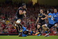 Luke Charteris of Wales breaks away from the tackle from Italy's Leonardo Ghiraldini. Wales v Italy, RWC warm up international match at the Millennium Stadium in Cardiff ,South Wales on Saturday 5th Sept  2015. pic by Andrew Orchard, Andrew Orchard sports photography.