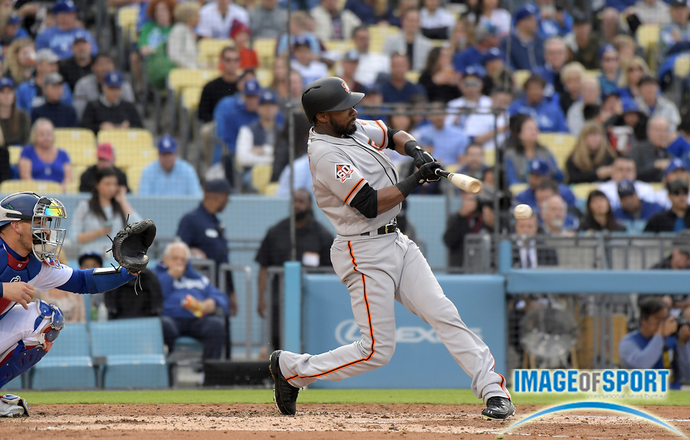 Apr 1, 2018; Los Angeles, CA, USA; San Francisco Giants center fielder Austin Jackson (16) bats against the Los Angeles Dodgers during a MLB baseball game at Dodger Stadium.The Dodgers defeated the Giants 9-0.