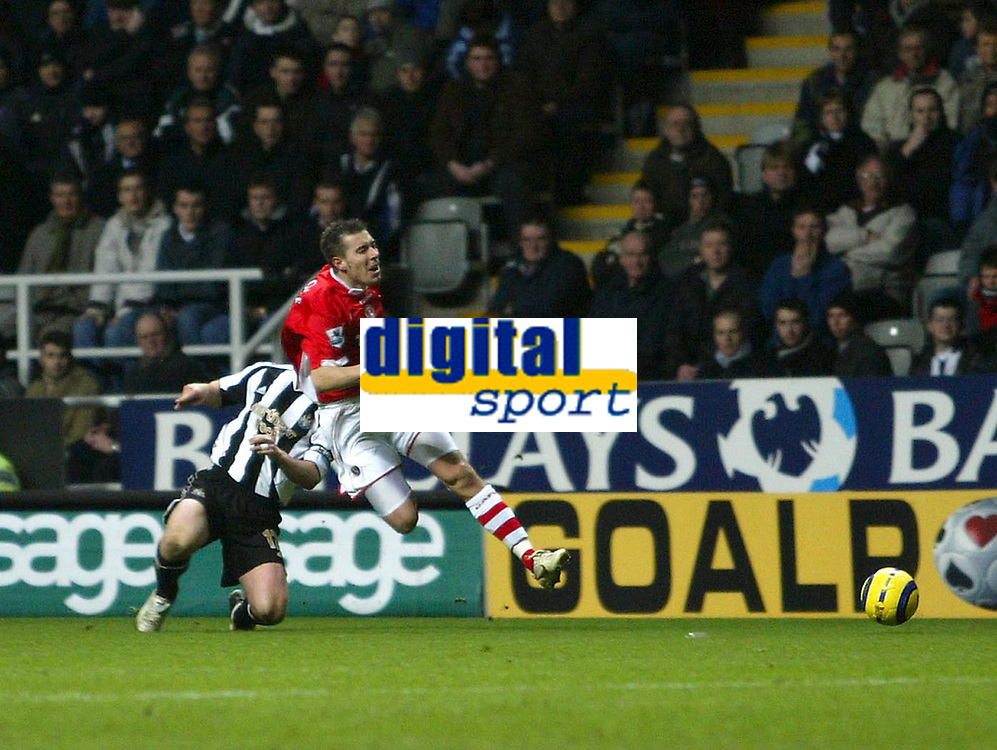 Photo: Andrew Unwin.<br /> Newcastle United v Charlton Athletic. The Barclays Premiership. 22/02/2006.<br /> Newcastle's Scott Parker (L) is shown the yellow card for his late challenge on Charlton's Darren Ambrose (R).