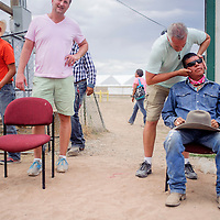 090514       Cable Hoover<br /> <br /> Kenny Young has his neck adjusted by chiropractor Bill Bollinger outside the Navajo Nation Fair Rodeo in Window Rock Saturday. Bollinger and fellow chiropractor Lucas Matlock were brought in to help treat the rodeo staff and competitors.