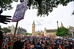 """© Licensed to London News Pictures. 27/06/2016. London, UK. """"Keep Corbyn"""" Momentum demonstration outside the Houses of Parliament in london. The majority of the Labour shadow cabinet resigned today (Mon) in protest at Corbyn's leadership. Photo credit: Ben Cawthra/LNP"""