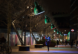 © Licensed to London News Pictures. 17/01/2018. London, UK. A woman photographs one of the giant office table lamps in an installation called 'Lampounette' ?by TILT in King's Cross during the Lumiere London festival. Running from 18th-21st January 2018 more than 50 artworks are ransforming the capital's streets, buildings and public spaces into an immersive nocturnal art exhibition of light and sound. Locations include King's Cross, Fitzrovia, Mayfair, West End, Trafalgar Square, Westminster, Victoria, South Bank and Waterloo. Photo credit: Peter Macdiarmid/LNP