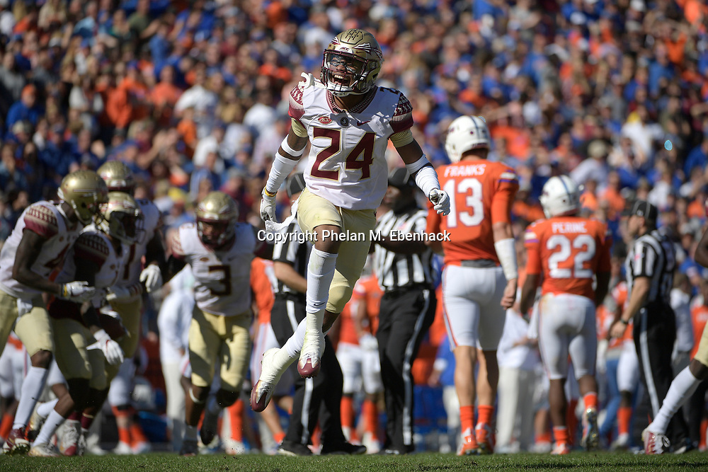 Florida State defensive back Cyrus Fagan (24) celebrates after an interception by defensive back Levonta Taylor (1) during the first half of an NCAA college football game against Florida Saturday, Nov. 25, 2017, in Gainesville, Fla. (Photo by Phelan M. Ebenhack)