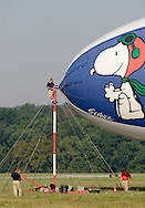 Montgomery, NY - Members of the ground crew, including one man on the mooring mast, prepare the MetLife blimp Snoopy Two for take off from Orange County Airport in Montgomery on July 26, 2008.