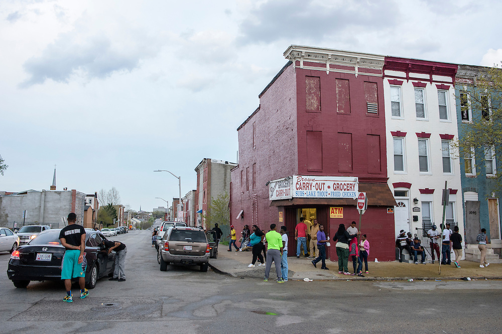 Baltimore, Maryland - April 20, 2015: People hang around on the block where the Western District Police Station in Baltimore is Monday after most of the people who protested the death of Freddie Gray left.<br /> <br /> <br /> CREDIT: Matt Roth for The New York Times<br /> Assignment ID: 30173608A