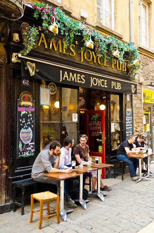 Patrons at the James Joyce Pub in old Lyon, France