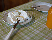 Fresh goat cheese with kumquat jam. Breakfast at Popi and Cortas's house. In and around Meronas village, Central Crete.