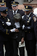 Natalia Harding(mother of Omar Edwards) at the funeral for NYPD Officer Omar Edwards held at Our Lady of Victory in Brooklyn on June 4, 2009..NYPD Officer Omar Edwards posthumusly promoted to the rank of Detective was killed by NYPD Detective Andrew Dunton in a case of friendly fire, when Edwards was takened for a suspect with gun in hand. On Thursday June 4 2009, Officer Omar J. Edwards, 25, was shot by a fellow officer on a Harlem street while in street clothes. He had just finished his shift, and had his service weapon out, chasing a man who had broken into his car, police said. Three plainclothes officers on routine patrol arrived at the scene and yelled for the two to stop, police said. One officer, Andrew Dunton, opened fire and hit Edwards three times as he turned toward them with his service weapon. It wasn't until medical workers were on scene that it was determined he was a police officer.