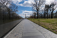 Washington, DC, USA -- February 14, 2020. A  wide angle photo looking up  from the Vietnam Veterans Memorial to the Washington Monument.