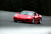 Image of a red Ferrari 360 Modena coupe at Pacific Raceways, Kent, Washington, Pacific Northwest by Ferrari photographer Randy Wells