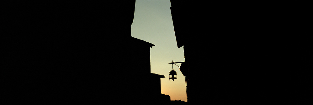 Lamp in silhouette with sky
