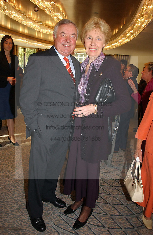 JIMMY TARBUCK and JOAN MORECAMBE at the Lady Taverners Tribute lunch in honour of Ronnie Corbett held at The Dorchester Hotel, Park Lane, London on 3rd November 2006.<br />