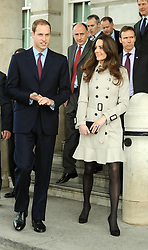 Prince William and Kate Middleton leave Belfast City Hall during their visit to Northern Ireland.