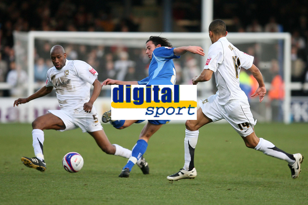 Photo: Pete Lorence/Sportsbeat Images.<br />Peterborough United v Milton Keynes Dons. Coca Cola League 2. 15/12/2007.<br />Boyd fires the ball up the pitch past Drissa Diallo