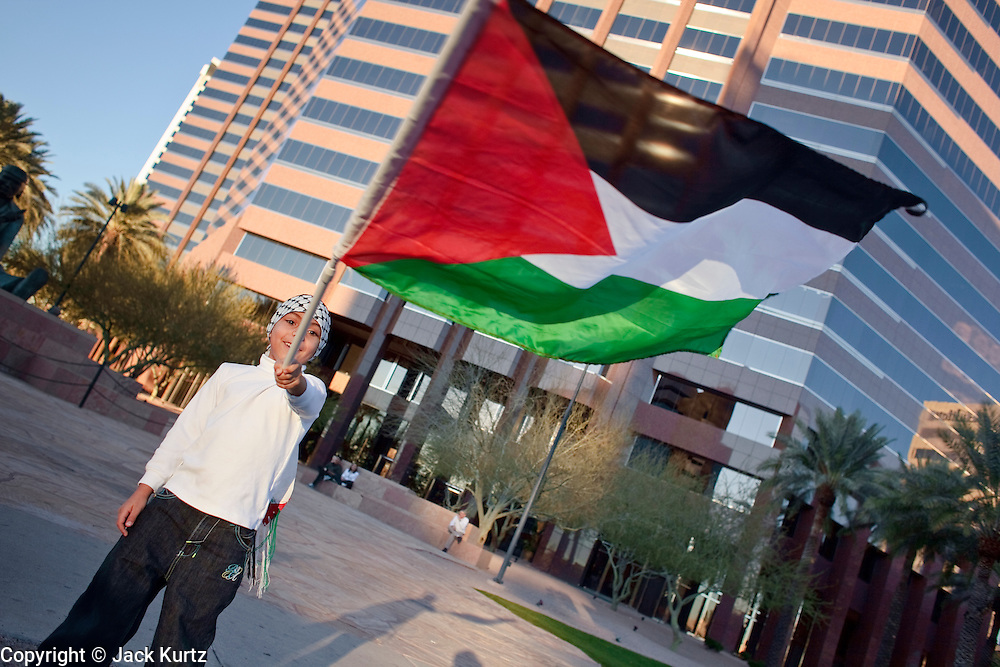 30 DECEMBER 2008 -- PHOENIX, AZ: MALIK ZDOUQ, 6, a Palestinian-American, waves the Palestinian flag and chants in favor of Palestinian rights at an intersection in Phoenix Tuesday. About 200 people from a variety of human rights and peace activists organizations in Phoenix, AZ, marched in opposition to the Israeli attacks on Gaza and in favor of Palestinian rights on Tuesday, the fourth day of Israeli air strikes on Hamas facilities in Gaza. Photo by Jack Kurtz / ZUMA Press