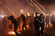 A couple slow dances as dozens of sky rockets explode around them during the Alborada festival September 29, 2018 in San Miguel de Allende, Mexico. The unusual festival celebrates the cities patron saint with a two hour-long firework battle at 4am representing the struggle between Saint Michael and Lucifer.