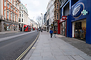The shopping district Oxford Street empty of shoppers and traffic as the national coronavirus lockdown three continues on 28th January 2021 in London, United Kingdom. Following the surge in cases over the Winter including a new UK variant of Covid-19, this nationwide lockdown advises all citizens to follow the message to stay at home, protect the NHS and save lives.