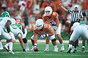 AUSTIN, TX - AUGUST 30:  David Ash #14 of the Texas Longhorns reads the defense against the North Texas Mean Green on August 30, 2014 at Darrell K Royal-Texas Memorial Stadium in Austin, Texas.  (Photo by Cooper Neill/Getty Images) *** Local Caption *** David Ash