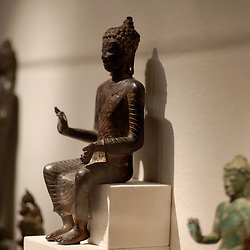 At the Walter's Art Museum in the Mount Vernon neighborhood of Baltimore, a collection of Thai statuettes grace a room in the extensive  Asia area of the museum...Photo by Susana Raab