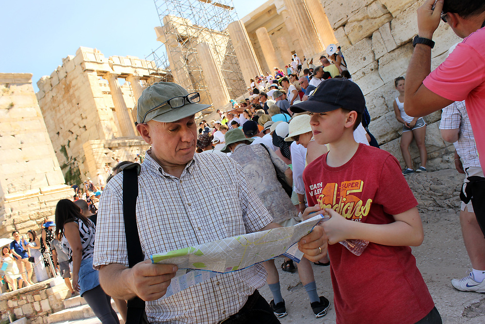 Father and son looking at tourist map whilst visiting Acropolis Parthenon, Athens, Greece.Dog, New Mexico, USA