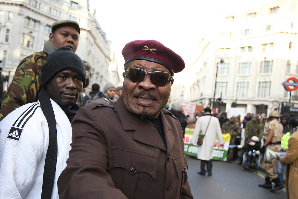 © UK News Pictures 14/12/2010. An angry demonstration in central London by up to 500 people against the re-election of President Joseph Kabila in the Democratic Republic of Congo. Picture credit should read: Brian Duckett/UK News Pictures