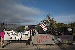 Environmental activists stand holding banners in solidarity with HS2 Rebellion to block a gate providing access to a site for the HS2 high-speed rail link on 12 September 2020 in Harefield, United Kingdom. Anti-HS2 activists continue to try to prevent or delay works on the controversial £106bn HS2 high-speed rail link in the Colne Valley where thousands of trees have already been felled.