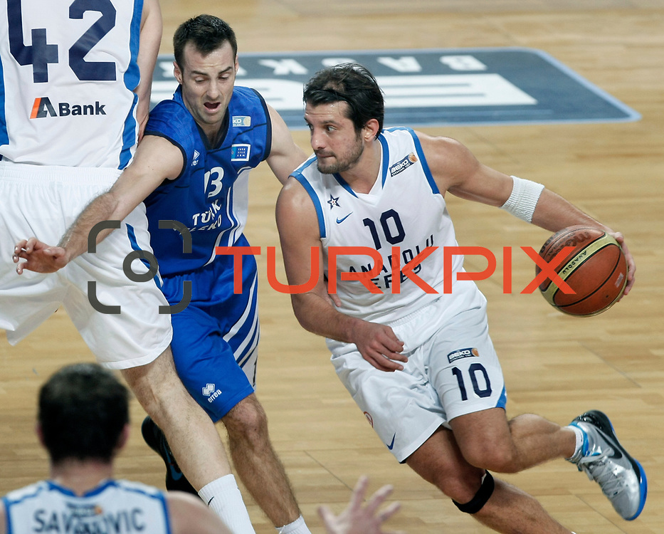 Anadolu Efes's Kerem Tunceri (R) during their Turkish Basketball League match Anadolu Efes between Turk Telekom at Arena in Istanbul, Turkey, Wednesday, January 04, 2012. Photo by TURKPIX