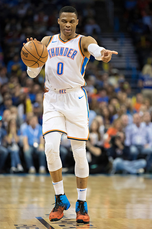 OKLAHOMA CITY, OK - OCTOBER 25:  Russell Westbrook #0 of the Oklahoma City Thunder directs the offense during a game against the Indiana Pacers at the Chesapeake Energy Arena on October 25, 2017 in Oklahoma City, Oklahoma.  NOTE TO USER: User expressly acknowledges and agrees that, by downloading and or using this photograph, User is consenting to the terms and conditions of the Getty Images License Agreement.  The Thunder defeated the Pacers 114-96.  (Photo by Wesley Hitt/Getty Images) *** Local Caption *** Russell Westbrook