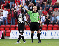 Photo: Chris Ratcliffe.<br />Leyton Orient v Swansea City. Coca Cola League 1. 26/08/2006.<br />Leon Knight (centre) of Swansea is sent off by referee Andy Hall for a second dive.