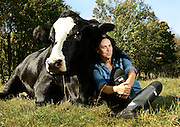 """Tracey Stewart spends time at the Farm Sanctuary in Watkins Glen, NY, Thursday, Sept. 24, 2015. Stewart wrote a book, """"Do Unto Animals"""". *<br /> (Photograph by Heather Ainsworth)"""