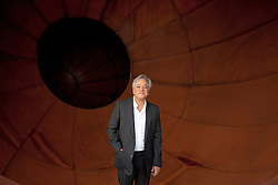 © Licensed to London News Pictures. 09/10/2012. LONDON, UK. Artist Anish Kapoor stands inside his sculpture 'Intersection' (2012) at a press view ahead of his new exhibition at the Lisson Gallery in London today (09/12/12) . The exhibition, the first since the artists solo exhibition at the Royal Academy of the Arts in 2009, features new works by Kapoor and runs from the 10th of October to the 10th of November 2012. Photo credit: Matt Cetti-Roberts/LNP