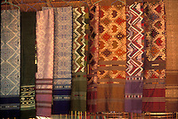 woven and embroidered cloths and scarves in a shop in Luang Prabang, Laos, a UNESCO World Heritage Center.