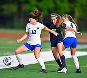 Althoff midfielder Emma Tell (center) battles for the ball with Columbia players Kyra Bivins (left) and Alexa Hildebrand. Althoff played Columbia in the sectional championship game at Althoff High School in Belleville, IL on Friday June 11, 2021. <br /> Tim Vizer/Special to STLhighschoolsports.com.