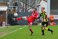 Oldham defender Cameron Dummigan stretches for the ball during the Sky Bet League 1 match between Burton Albion and Oldham Athletic at the Pirelli Stadium, Burton upon Trent, England on 26 March 2016. Photo by Aaron Lupton.