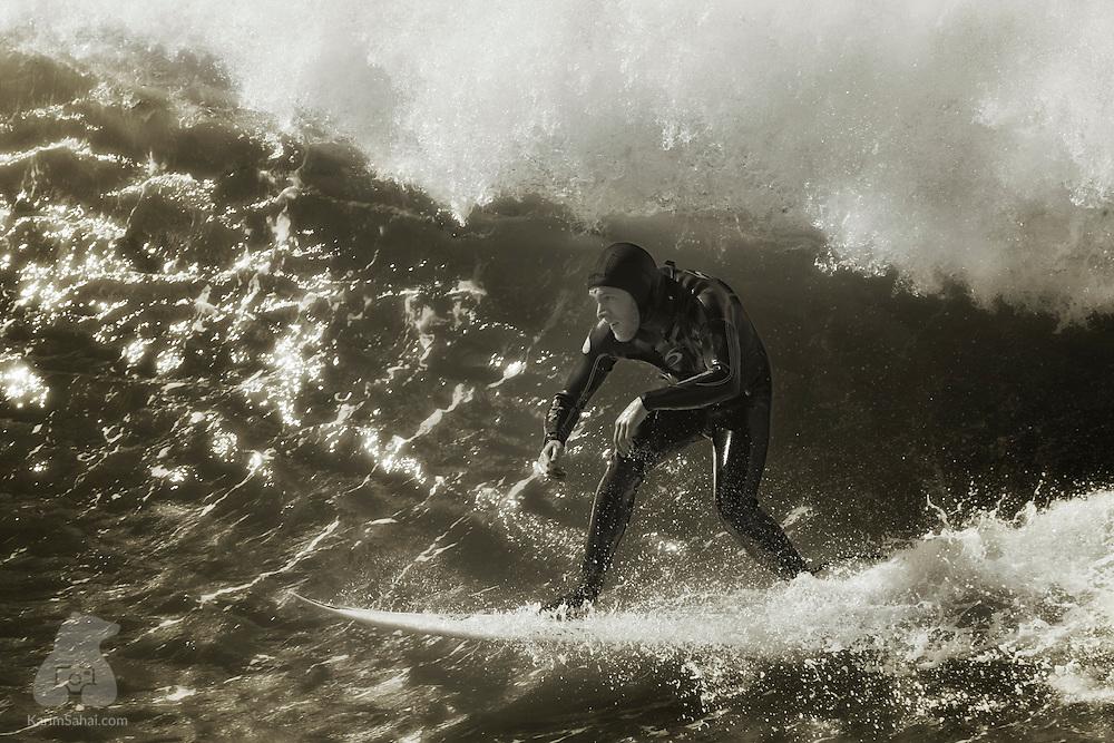 Surfer at Lyall Bay, Wellington, New Zealand.