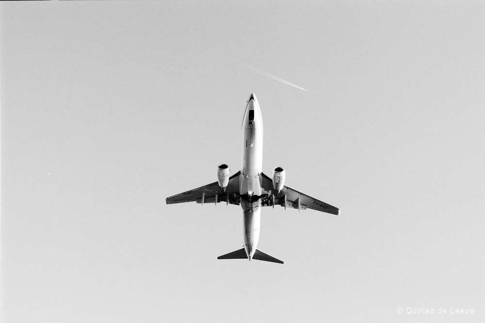 A KLM 737 plane on final approach at Schiphol Airport