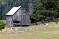 This barn was constructed in 1935 on Daniel Henry Ruckle's farm.  It currently is used for hay and machinery storage. Photographed in Ruckle Provincial Park on Saltspring Island, British Columbia, Canada.