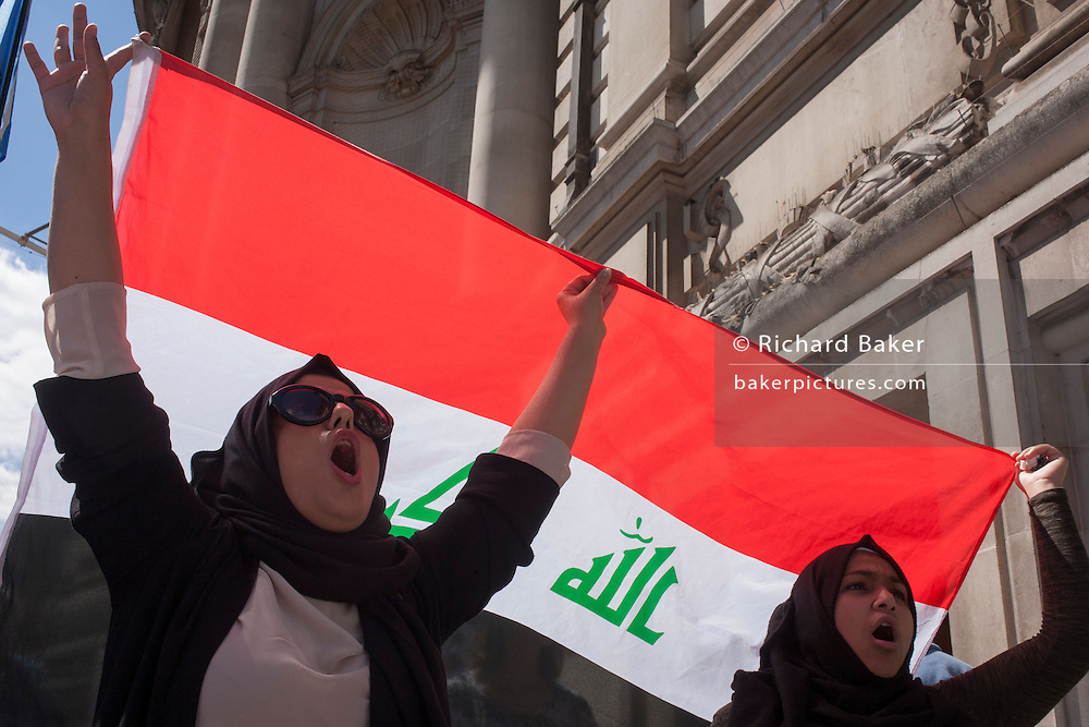 Two women holding the Iraqi flag shout their disapproval for former British Prime Minister Tony Blair on the day that the Chilcott Enquiry into how Britain went to war with the US in Iraq, was published.