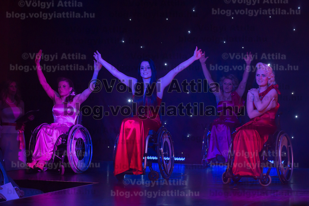 Girls perform on stage during the Miss Colours International wheelchair beauty contest in Budapest, Hungary on March 22, 2014. ATTILA VOLGYI