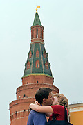 Moscow, Russia, 14/07/2006..A young couple kiss on Manezh Square by the Kremlin during a heatwave.