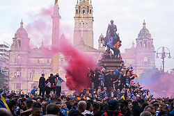 Glasgow, Scotland, UK. 15 May 2021. Thousands of supporters and fans of Rangers football club descend into George Square in Glasgow to celebrate winning the Scottish Premiership championship for the 55th time and the first time for 10 years. Iain Masterton/Alamy Live News