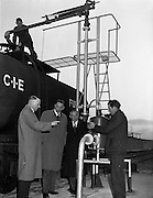 23/01/1959<br /> 01/23/1959<br /> 23/01/1959                                                                                                                                                                                                                                                                                                                                                                                                                                                                                                                                                                                                                                                                                                                                                                                                                                                                                                                                                                                                                                                                                                                                                                                                                                                                                                                                                                                                                                                                                                                                                                                   <br /> C.I.E. fuel tanks at Dublin Docks. C.I.E. officials observe the rail tanker being filled at the port.